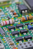 Electronic board. Green electronic board with a built-in resistors and semiconductors Royalty Free Stock Photography
