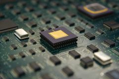 Electronic board with cpu processor and electronic chips technol. Ogy concept background with DOF Effect Royalty Free Stock Image