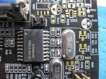 Electronic board with electrical components. Electronics of computer equipment.  Stock Photo
