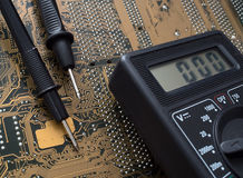 Electronic board and multimeter royalty free stock photography