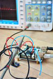Electronic board test with oscilloscope Stock Photo