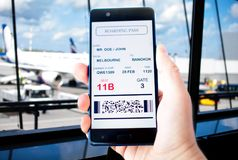 Electronic boarding pass on the screen of smartphone Stock Photo