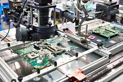 Electronic boards and chips and microscope. Electronic boards and chips and industrial microscope stock images