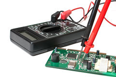 Electronic boards and digital multimeter Royalty Free Stock Photography