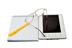 The electronic book, glasses, handle and notebook Royalty Free Stock Image