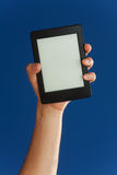 Electronic book in hand Royalty Free Stock Photography