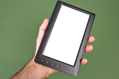 Electronic book is in a masculine hand Royalty Free Stock Photography