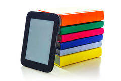 Electronic book reader with hard cover books Stock Image