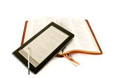 Electronic book reader laying on Bible Royalty Free Stock Photos
