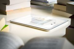 Electronic book reader. Modern smart device for reading. stock photos