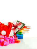 Electronic book reader with stack of books in bag Royalty Free Stock Photos