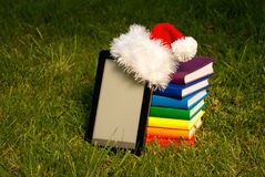 Electronic book reader wearing Santa's hat Stock Photo