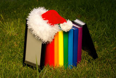 Electronic book reader wearing Santa's hat Stock Image