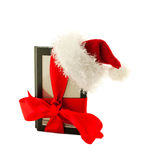 Electronic book reader wearing Santa's hat Royalty Free Stock Images