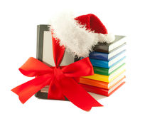 Electronic book reader wearing Santa's hat royalty free stock photography