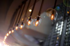 Electronic Bulb Light hanging in Restaurant bar. Electronic Bulb Light hanging in Restaurant softdrink Bar decor, decoration of garland with light bulb classic stock photography