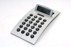Electronic calculator. An electronic calculator on white background royalty free stock image