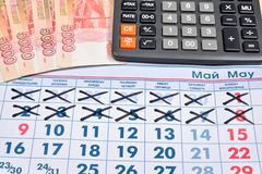 Electronic calculator and banknotes of five thousand rubles are Royalty Free Stock Photography