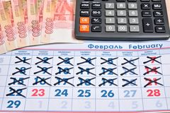 Electronic calculator and banknotes of five thousand rubles are Royalty Free Stock Image