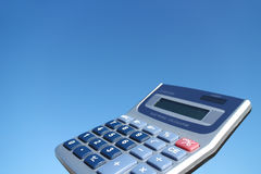 Electronic calculator in the blue sky Royalty Free Stock Photography