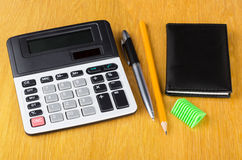 Electronic calculator, notepad, pen, sharpener  and pencil Stock Images