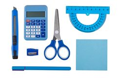 Electronic calculator and other stationery tools of blue color isolated on white. Background. Top view royalty free stock images