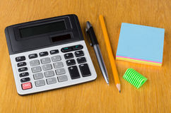 Electronic calculator, paper, pen, sharpener  and pencil Royalty Free Stock Photography