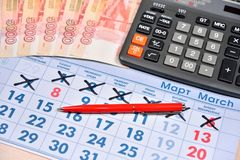 Electronic calculator, red pen and banknotes of five thousand ru Stock Photo