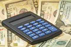 Electronic calculator and USA dollar banknotes. Stock Photography