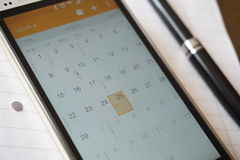 Electronic calender in the cell phone organizer. Focusing on Good Friday Holiday Stock Photos