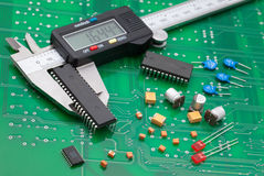 Electronic caliper measure IC and electronic part on green pcb.  stock photos