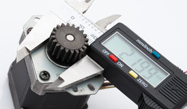 Electronic caliper measure size of gear.  stock photo