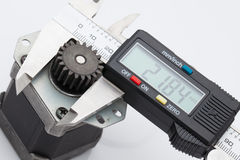 Electronic caliper measure size of gear.  royalty free stock photography