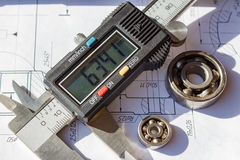 Electronic caliper and used ball bearings closeup royalty free stock photography