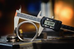 Electronic calipers on an old bearing detail royalty free stock image
