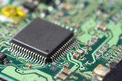 Electronic chip on circuit board Royalty Free Stock Images