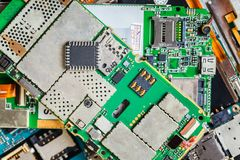 Electronic chip on a disassembled mobile phone royalty free stock images