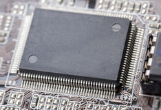 Electronic chip on computer circuit board. Macro Stock Image