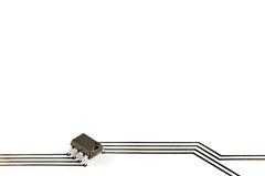 Electronic chip with printed tracks. Design elements formed of an electronic chip and tracks printed on paper royalty free illustration