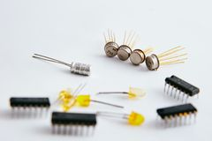 Electronic chip and radio components. Electronic chip and radio parts on a white background, good composition royalty free stock image