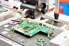 Electronic chips and industrial microscope. Electronic boards and chips and industrial microscope royalty free stock images