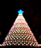 Electronic Christmas tree bokeh lights santa night. Electronic Christmas tree decoration with colorful lights Stock Photos
