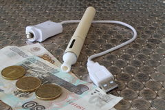 Electronic Cigarette on a background. Of money Royalty Free Stock Images