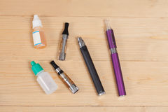 Electronic cigarette  on a background of wood Stock Photos
