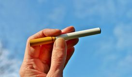 Electronic cigarette battery powered vapour ecigarettes Stock Photography