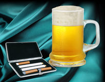 Electronic cigarette and beer Royalty Free Stock Image