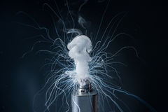 Electronic Cigarette on a black background and smoke from it Royalty Free Stock Photos