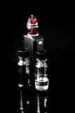 Electronic cigarette with 2 bottles. RDA Mage coilart tank with 2 liquid bottles Royalty Free Stock Photography