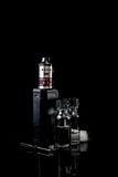 Electronic cigarette with 2 bottles. RDA Mage coilart tank with 2 liquid bottles, screwdriver, coil and cotrton Stock Photo