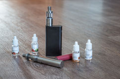 Electronic Cigarette with liquids and batteries Royalty Free Stock Photos
